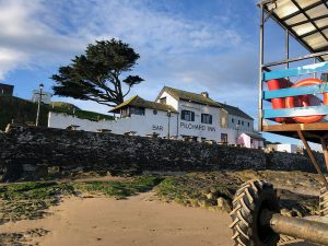A view of the Pilchard Inn from the beach